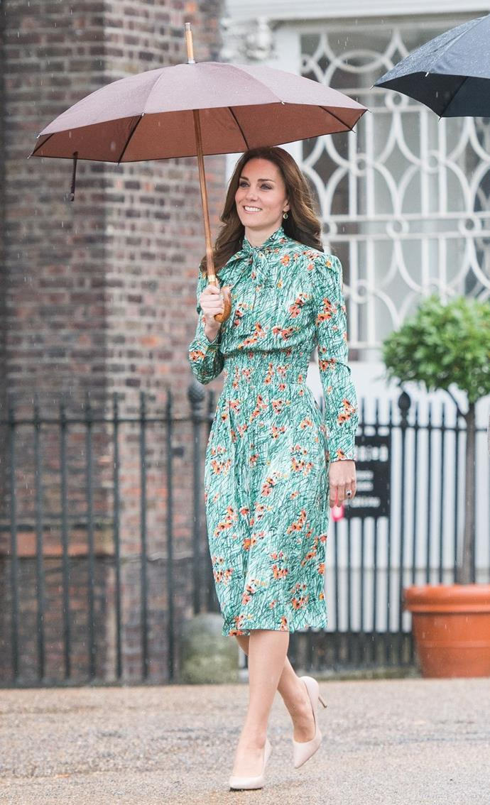 **$3,026** On August 30, Kate visited the Diana Memorial Garden in a green Prada dress.
