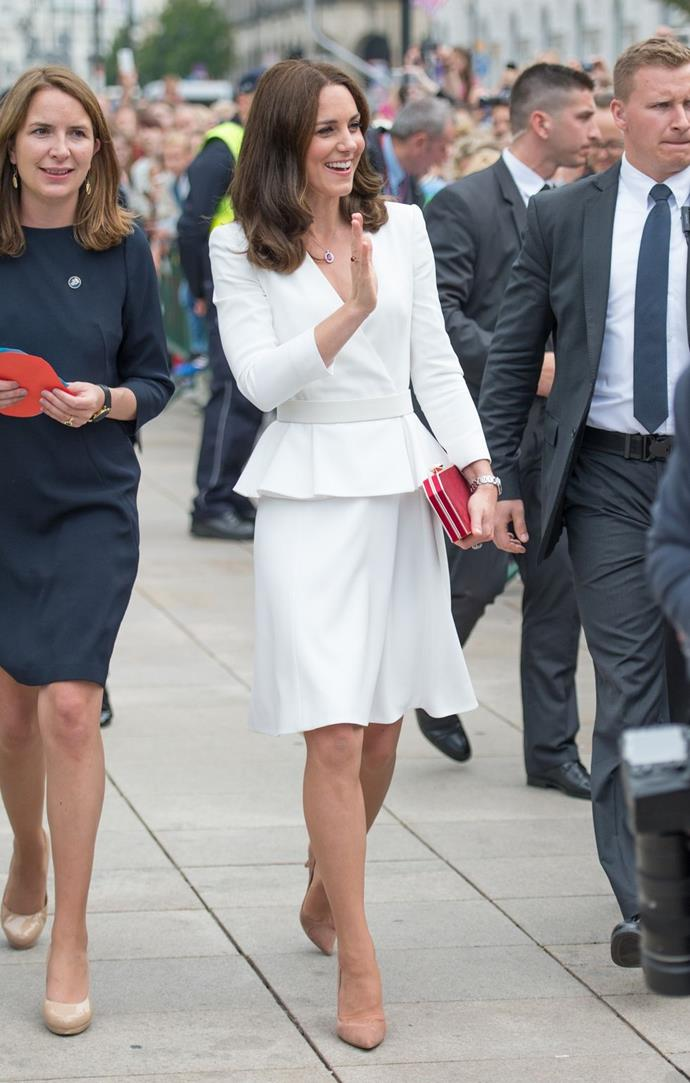 **$3,453** On July 17, Kate started her royal tour of Warsaw in an Alexander McQueen peplum coat.