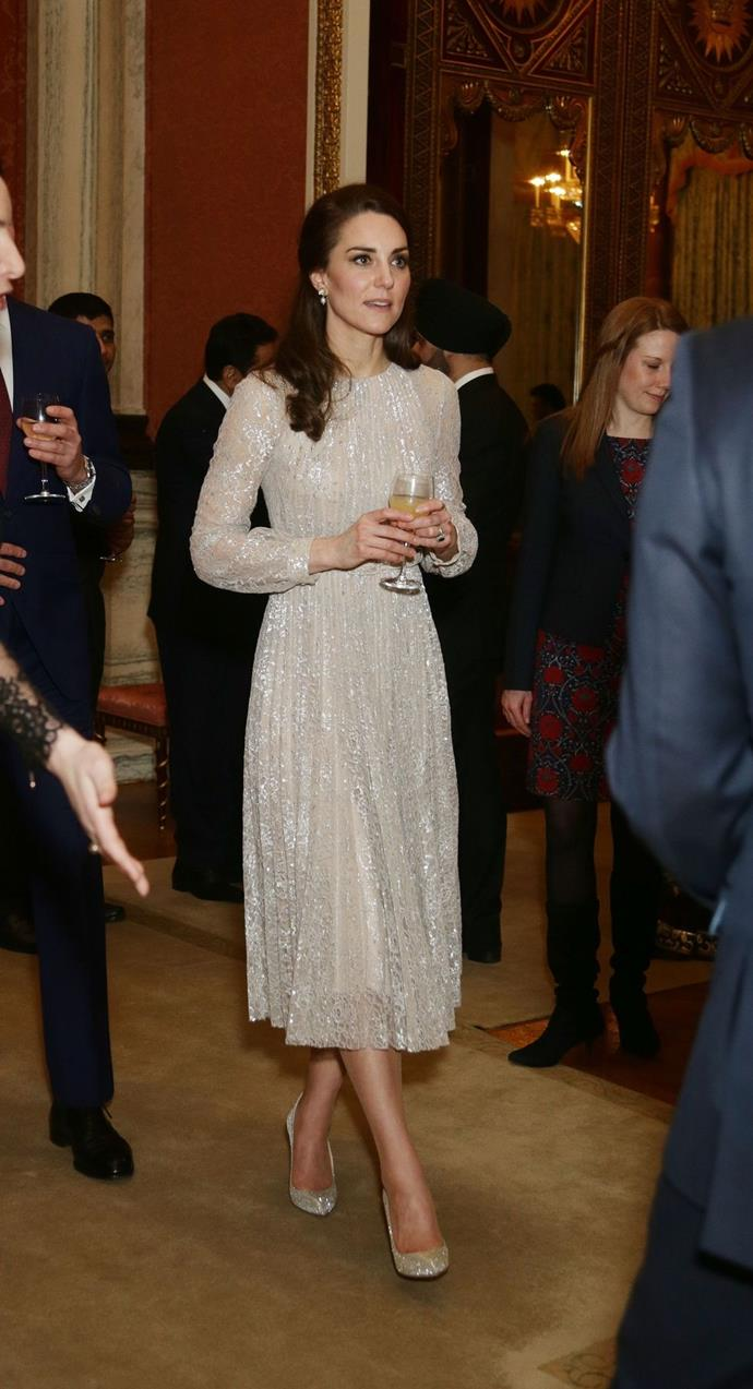 **$4,494** On February 27, Kate attended the UK-India Year of Culture reception at Buckingham Palace wearing an Erdem dress, Oscar de la Renta shoes, and Anita Dongre earrings.