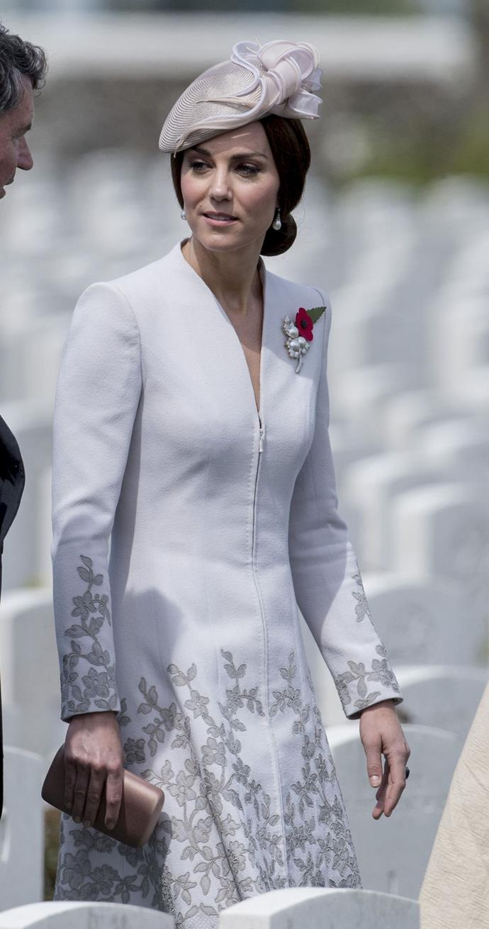 **$4,668** On July 31, Kate visited the Commonwealth War Graves Commission Cemetery in Belgium, wearing a Catherine Walker coat and new hat.