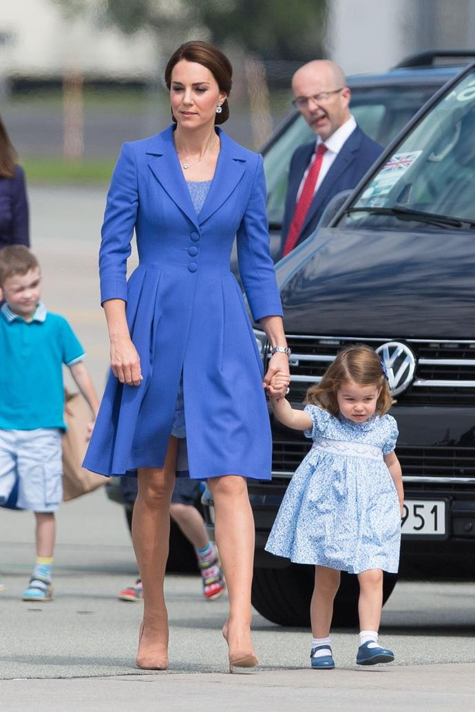 **$4,855** On July 19, Kate arrived in Germany in a Catherine Walker bespoke blue coat and dress and carrying a Jimmy Choo clutch.