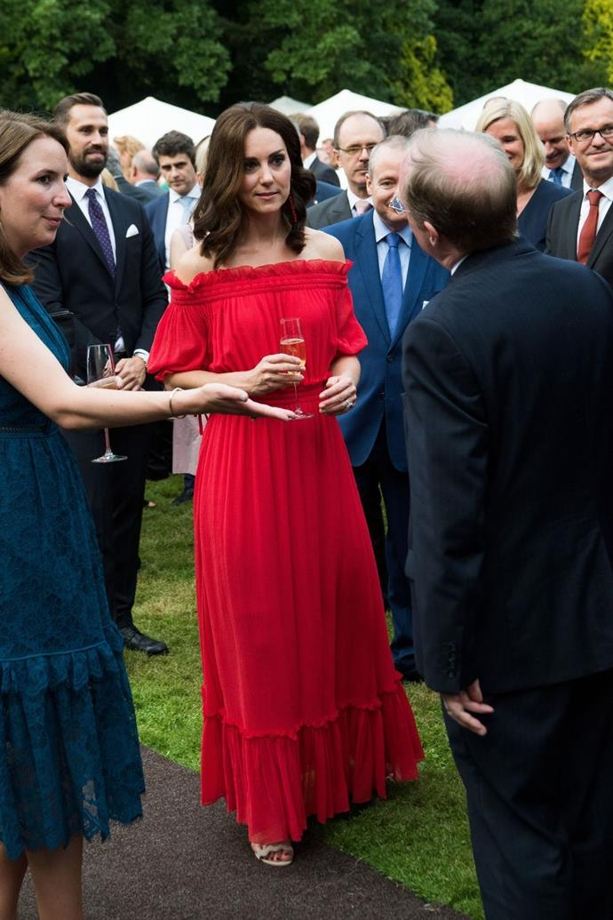 **$4,880** On July 19, Kate attended the Queen's birthday garden party in Berlin and wore an Alexander McQueen chiffon maxi dress, Prada Scalloped suede heels, and Simone Rocha Red PVC pendant earrings.