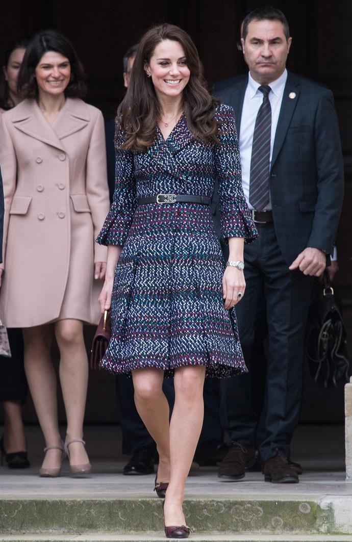 **$22,344** On March 18, while in Paris, Kate wore this expensive outfit, made up of a Chanel suit, Chanel handbag, Cartier earrings, and knee high boots.