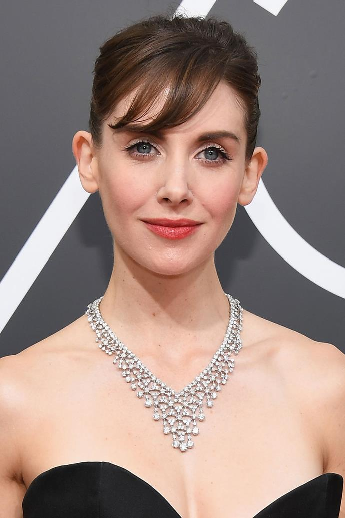 **Alison Brie** <br><br> Alison Brie's red carpet beauty look couldn't be further from her '80s glam look in her show *Glow*. Here, Brie makeup consists of a rose-toned trifeca on her lips, eyes and cheeks, and pairs it with with a simple updo and bangs.