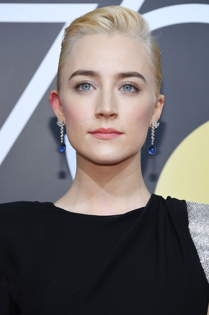 **Saoirse Ronan** <br><br> We can't think of anyone who could rock a slicked-back peroxide crop quite like the *Lady Bird* actress.