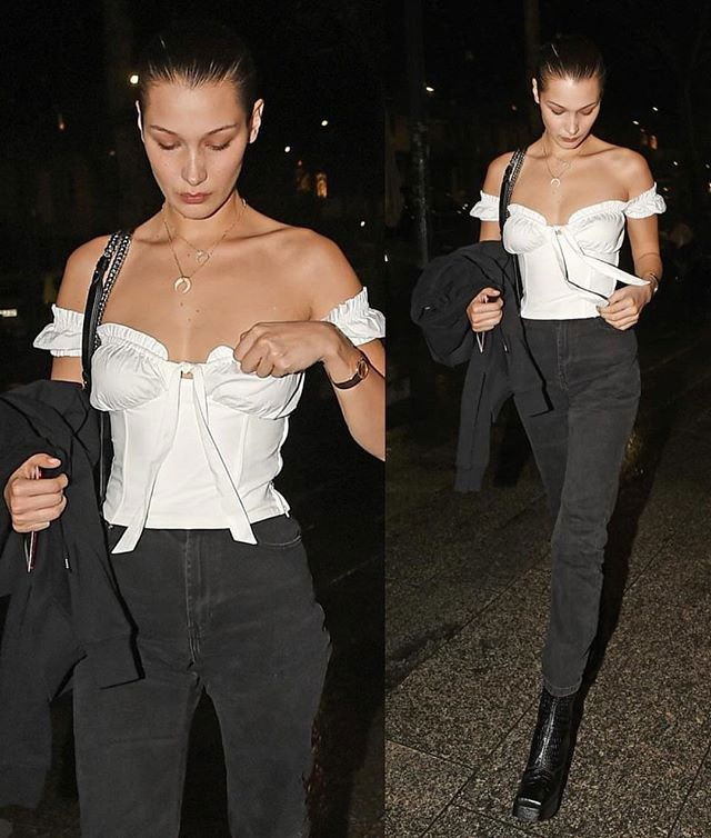 "**Bella Hadid**   Wearing [Naomi Top](https://iamgia.com/collections/tops/products/naomi-top-white|target=""_blank""