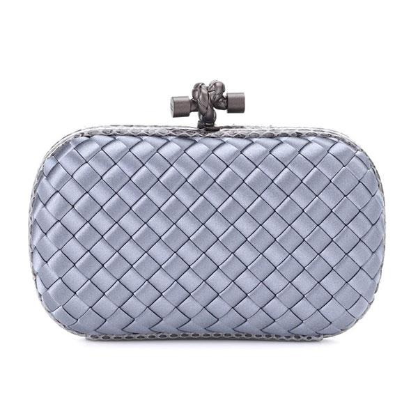 "Clutch, $2,065, Bottega Veneta at [My Theresa](https://www.mytheresa.com/en-au/000973-knot-satin-and-snakeskin-clutch-805249.html?catref=category|target=""_blank"")."