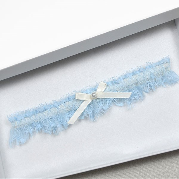 "Garter, $40, at [The Wedding Garter](https://www.theweddinggarter.com.au/tiffany-blue-eyelash-lace-ivory-wedding-garter|target=""_blank"")."