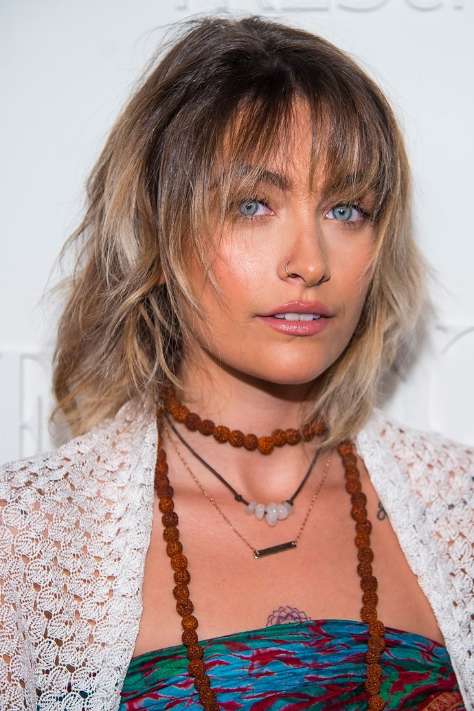 Judging by her foray into whispy bangs, Paris is definitely not afraid to experiment with her look. And lets not forget to mention that amazingly bronzed skin!