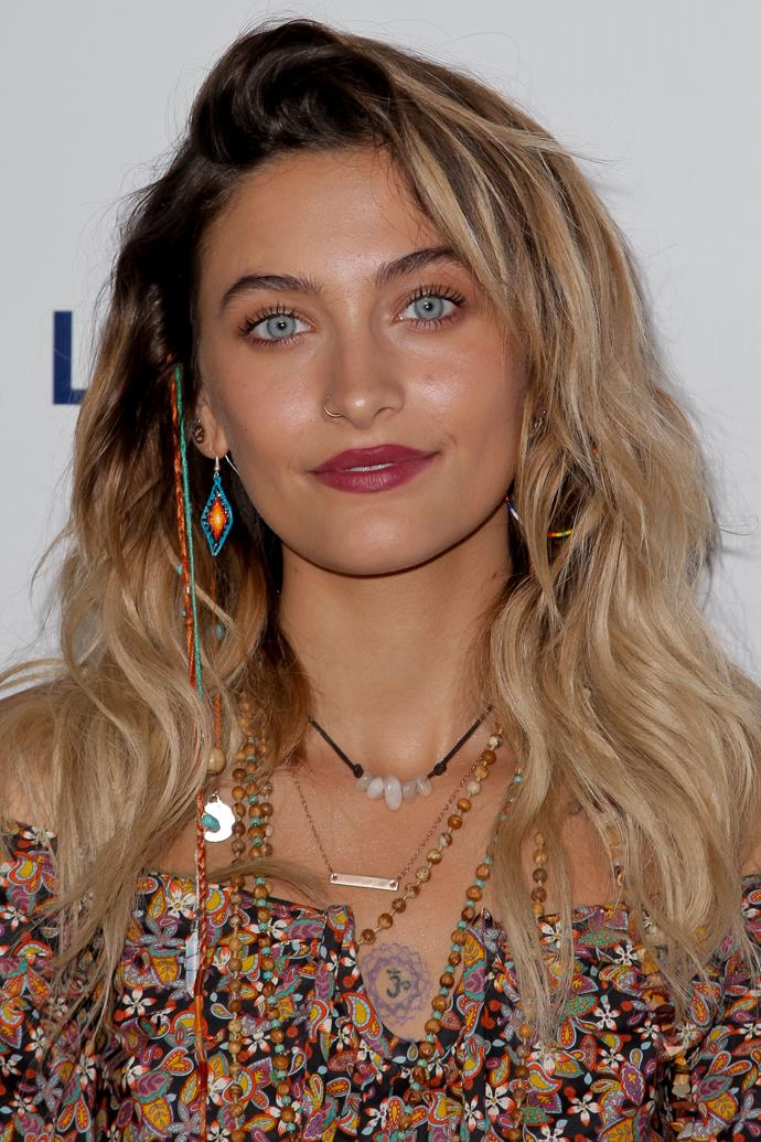 Not that we don't love her in a stripped back look, but this berry lip and copper eyeshadow combo, paired with boho clip-ins, is definitely Paris' vibe.