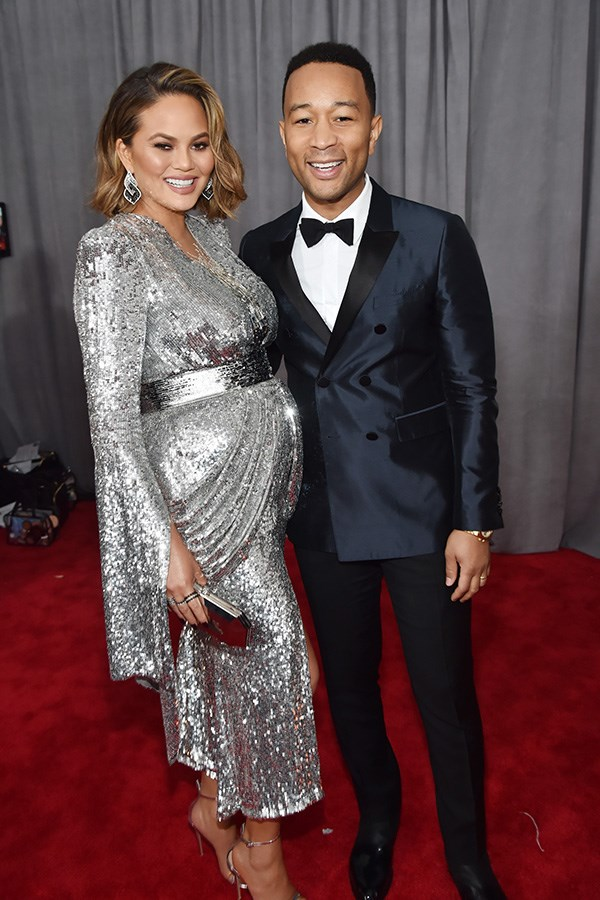 Chrissy Teigen, in Yanina Couture, and John Legend.