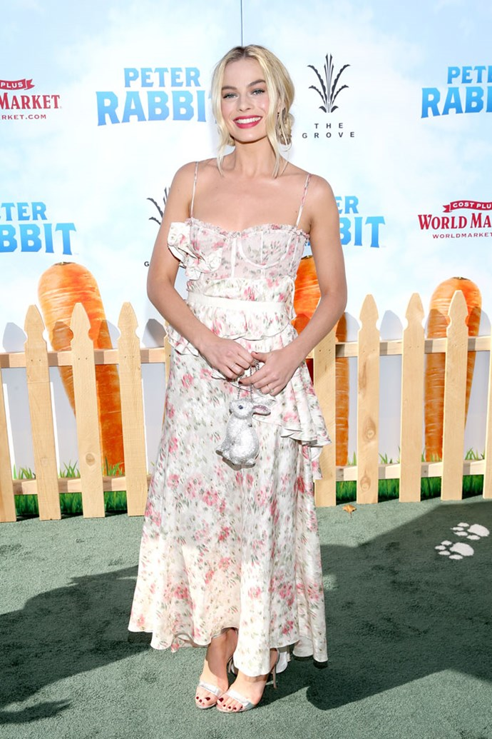 Margot Robbie stepped out at the *Peter Rabbit* premiere in Los Angeles wearing a heavenly floral Brock Collection dress, but all eyes were on her bag instead. Margot's embellished rabbit clutch is made by Judith Leiber, the same designer that created the famous black swan bag Mr. Big gave Carrie Bradshaw in *Sex And The City*.