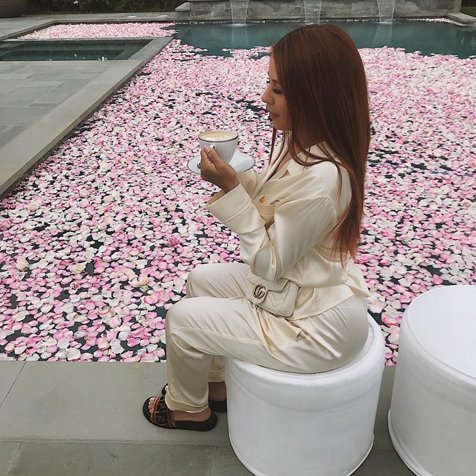 Yris Palmer sips on a cup of coffee at Kylie Jenner's baby shower.