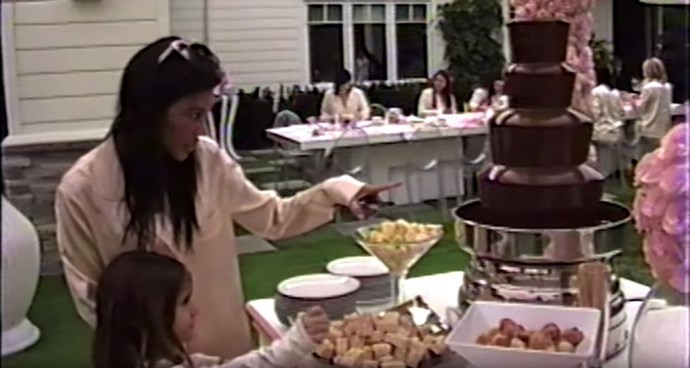 Kourtney Kardashian and Penelope Disick eye up the chocolate fountain at Kylie Jenner's baby shower.