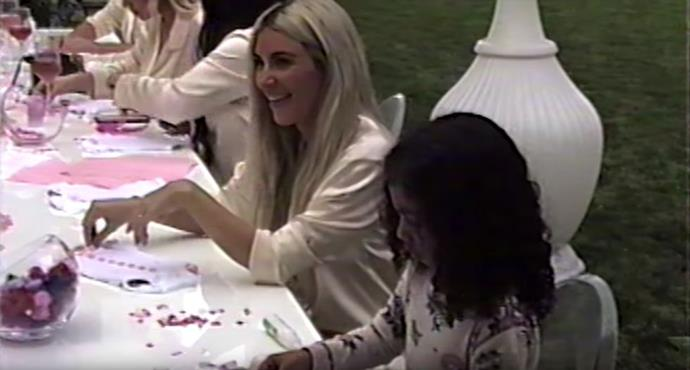 Kim Kardashian and North West decorate baby onesies at Kylie Jenner's baby shower.