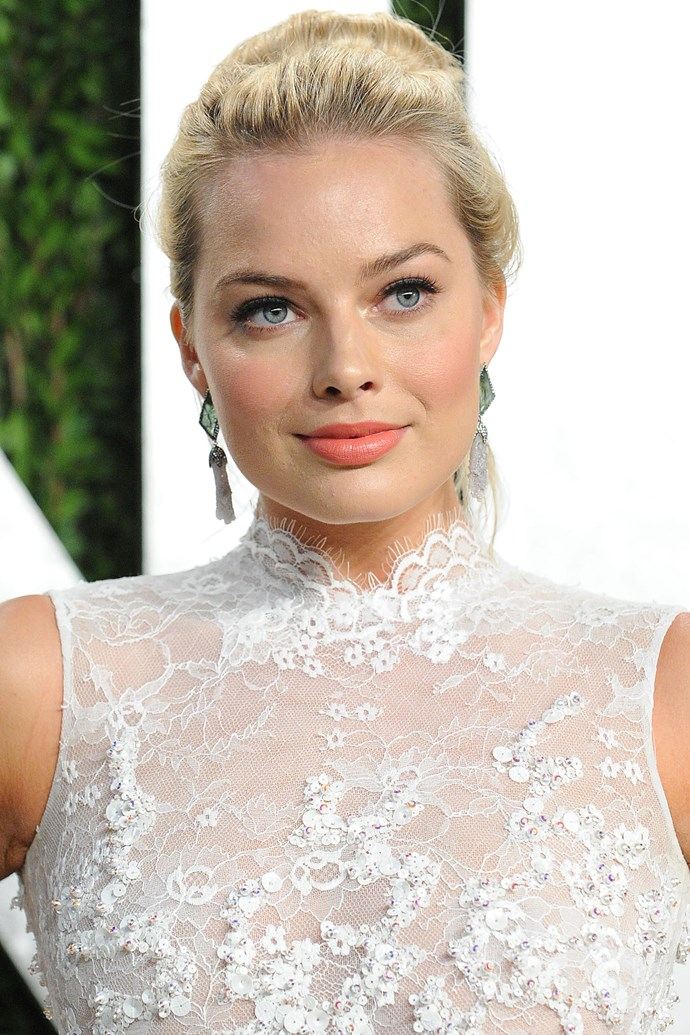Margot further refined her look in 2013, dying her hair a cool blonde tone and keeping her makeup to just a swipe of matte black liner and flushed cheeks.