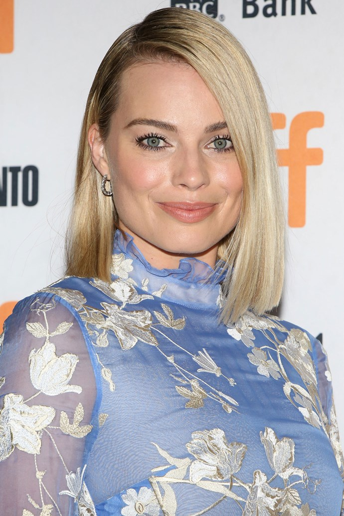Margot brings back her iconic lob for the third time, and it looks like it's sticking around for a while. She kept her token chop sleek, styling it in a deep side part, and paired it with light black liner.