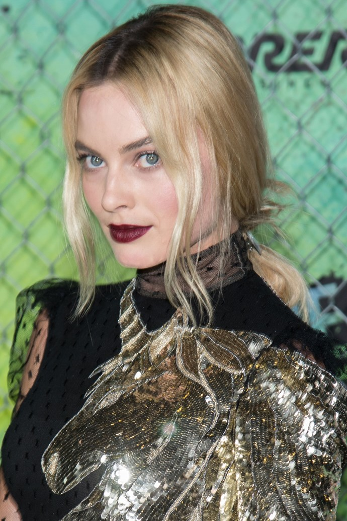 Margot channels goth chic with icy blonde tones, dark brows and a merlot lip.