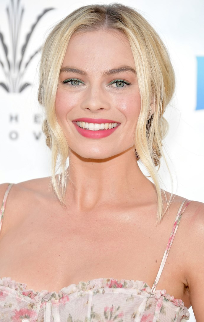 Once again, Margot absolutely nails the coloured lid! She keeps her *Peter Rabbit* red carpet style super feminine with intricate chignon bun and pop of pink on her lips.