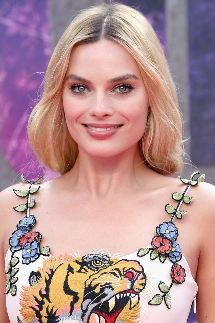 Just when you thought that Margot was the patron of the edgy red carpet look, she proves that she can do feminine and radiant just as well. The actress swept her long locks into a loose plait, and kept her makeup pretty and pink.