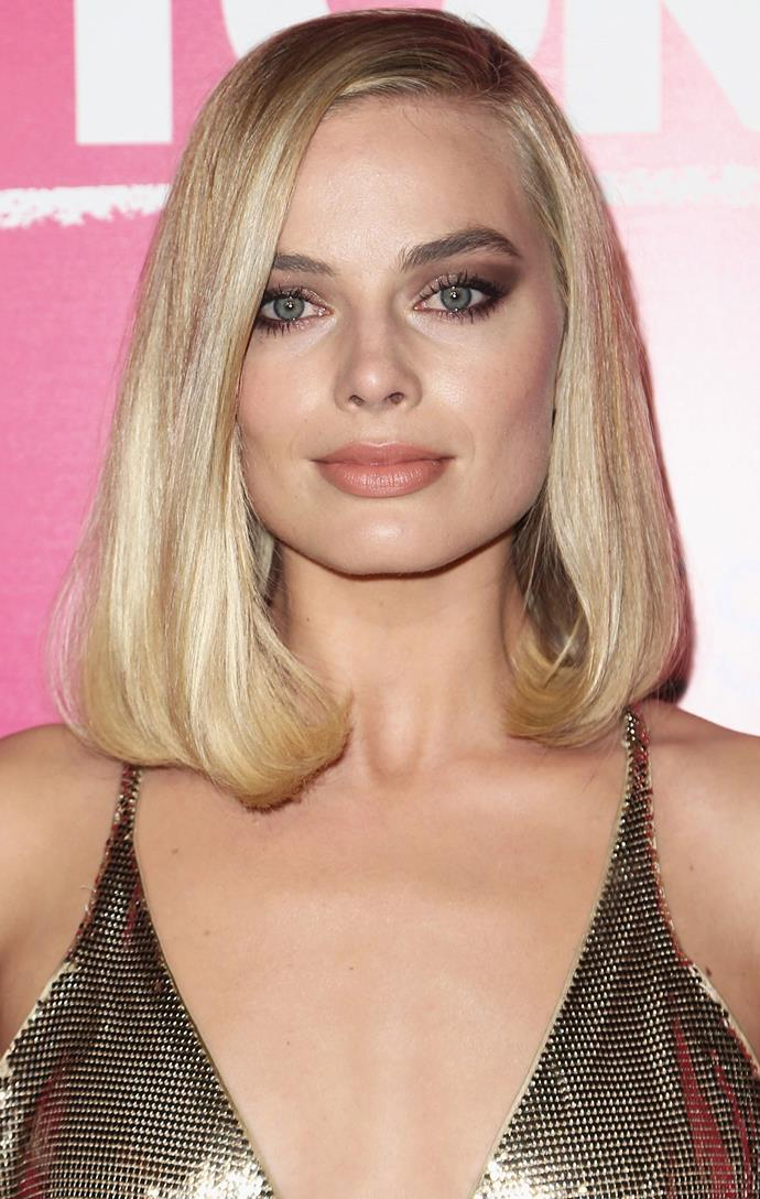 Is anyone else getting Michelle Pfeiffer in *Scarface* from this look? We are loving the bronze shadow cat eye and curled-in lob.