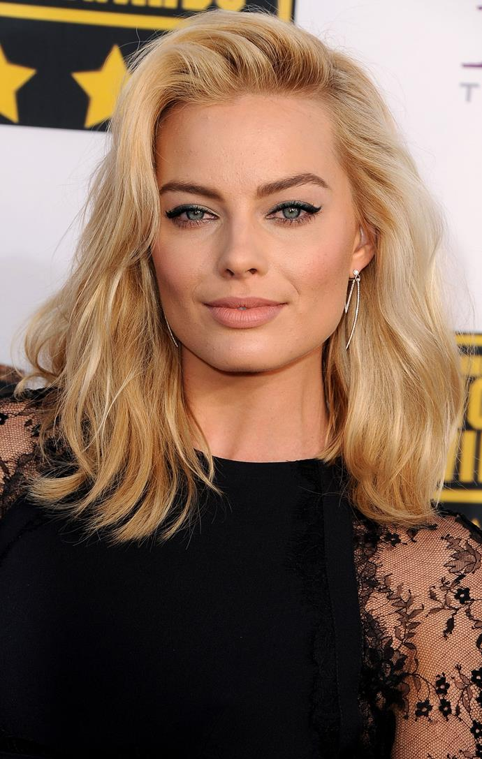 Hello bombshell! We will forever be trying to replicate this relaxed, 'morning after' style 'do and cat eye combo.