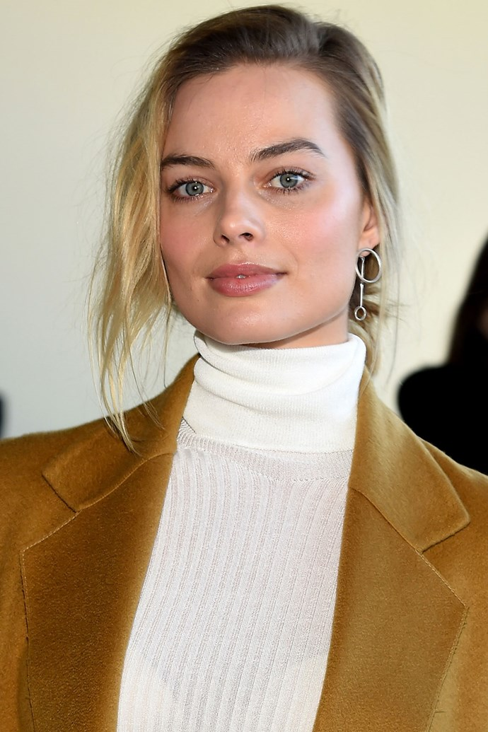 Margot nails classic beauty like no other, scooping her hair back into a messy bun and leaving a few strands to fall delicately by her face.