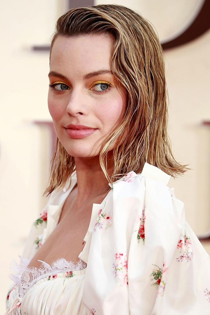 Robbie shows us ultimate wet-look hair goals at a red carpet event for her film *Goodbye Christopher Robin*. And speaking of goals, we've never seen anyone pull off a canary yellow lid quite like her.