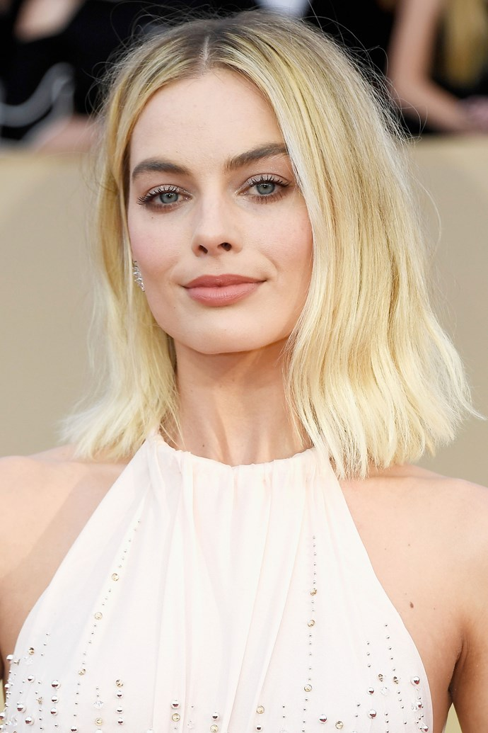 Margot marks her return to cool blonde tones at this year's SAG Awards, pairing them with a subtle glitter lid.