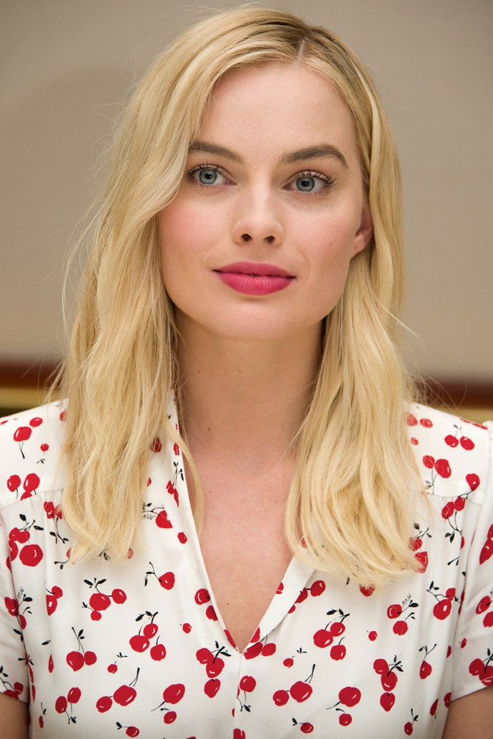 Margot is so frenchy so chic in a rosy pink lip, pink cheek combo, and low maintenance hair.