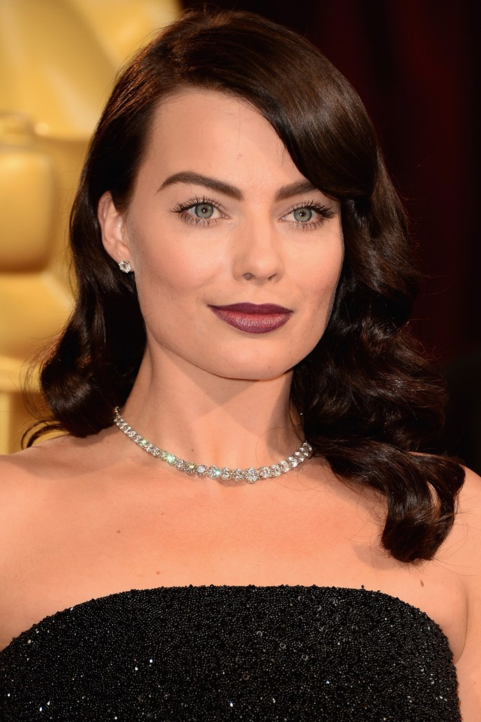 Debuting her most dramatic look change yet, the actress stepped out at the 2014 Oscars in a new dark look, complete with freshly-dyed brunette locks and a wine lip.