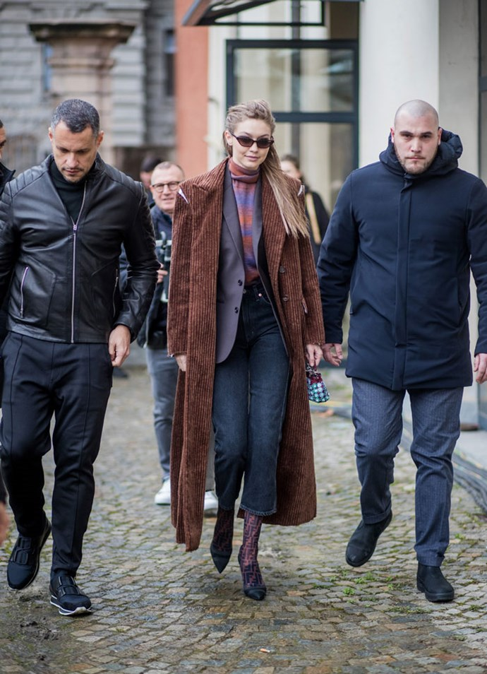 Gigi Hadid stepped out at Milan Fashion Week with a Fendi bag so tiny, we had to zoom in to see it.