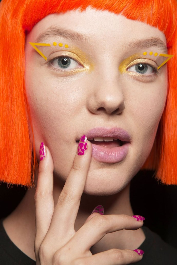 "**Jeremy Scott** <br><br> **The Vibe:** Neon Leopard <br><br> **Get the Look:** Inspired by Scott's colorful designs, nail artist Miss Pop for Essie opted for a neon animal print pattern on the nails. Miss Pop used one of three polishes: [Tart Deco](https://www.adorebeauty.com.au/essie/essie-nail-colour-tart-deco-88.html|target=""_blank""