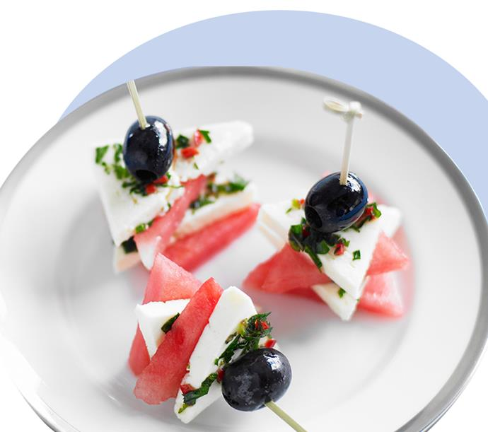 "Impress at your next soirée with these light [watermelon, olive and fetta bites](https://www.cosmopolitan.com.au/preview/lifestyle/party-food-recipes-26061|target=""_blank""). Sprinkled with chili, parsley and mint, they make elegant (and easy-to-make) cocktail canape delights. View the recipe [here](http://www.foodtolove.com.au/recipes/feta-watermelon-and-olive-bites-7723