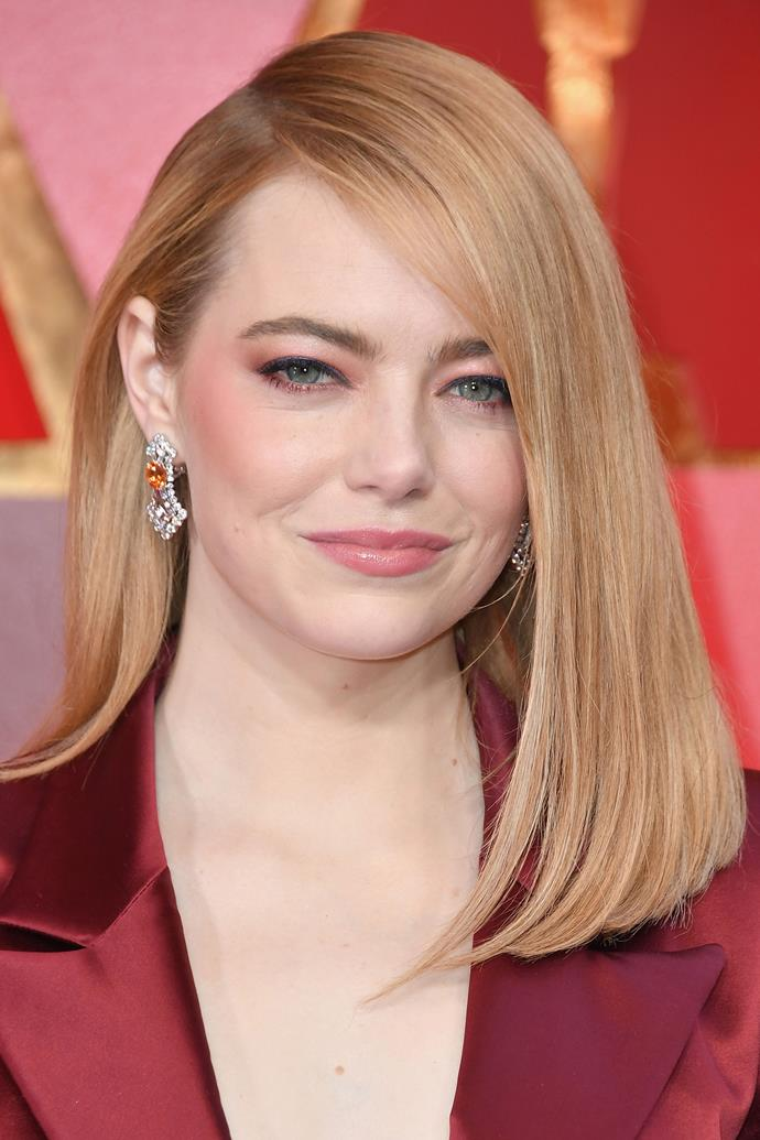 **Emma Stone** <br> As far as we're concerned, Emma Stone can do no wrong. This year, she wore a red, pink and navy Louis Vuitton pantsuit on the red carpet—and this hairstyle was the cherry on top.