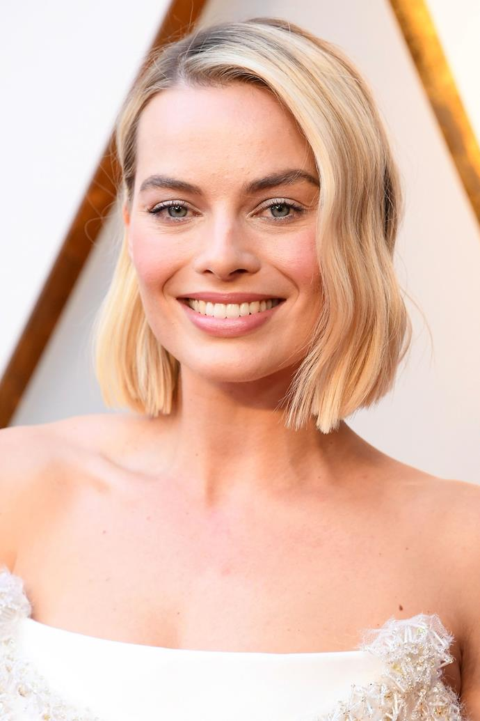 **Margot Robbie** <br> Australia's darling Margot Robbie looked like a living, breathing angel on the red carpet. Her lob had a slight wave, her pink lips matched her blush and her eyes featured a swipe of silver eyeshadow. In short, we love it all.