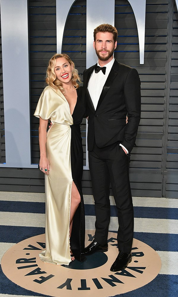 Miley Cyrus and Liam Hemsworth at the *Vanity Fair* Oscars party.