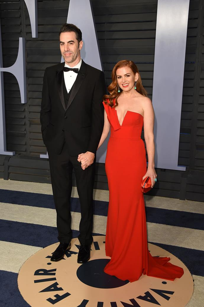 Sacha Baron Cohen and Isla Fisher at the *Vanity Fair* Oscars party.