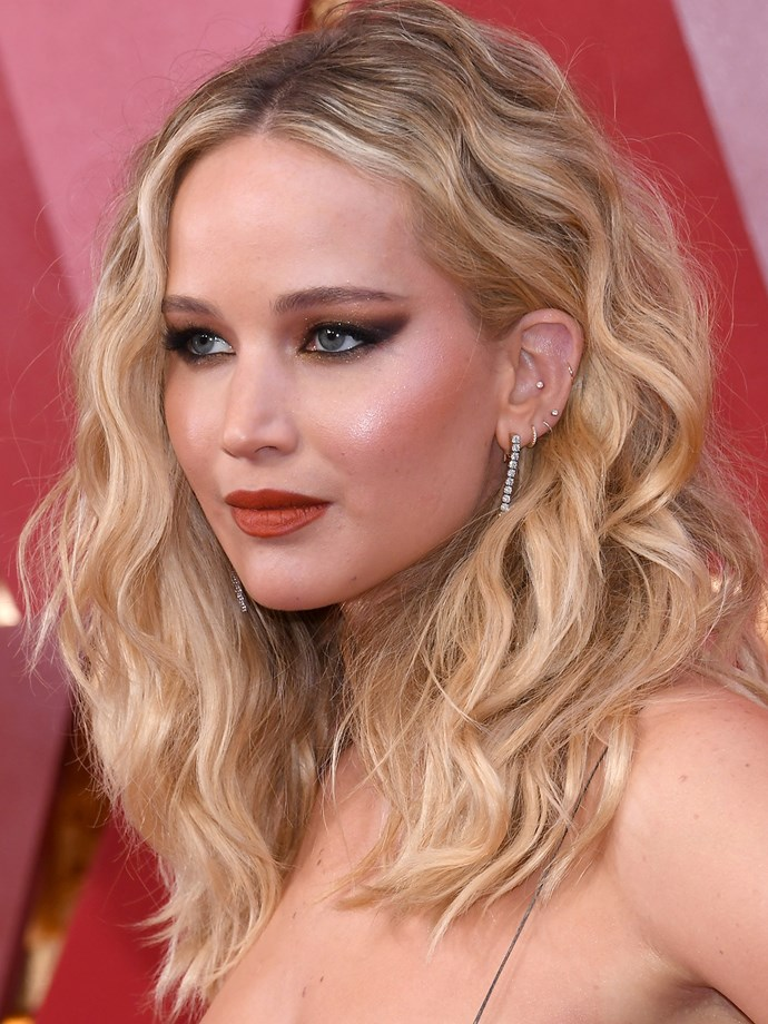 Jennifer Lawrence's left ear has at least six piercings, including four along her lobes, a conch and a helix.