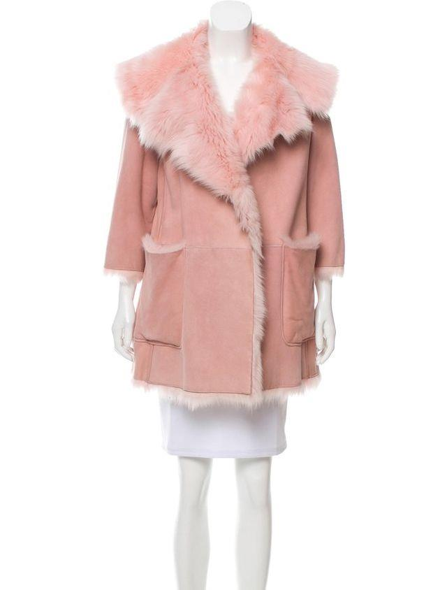 "Miu Miu Reversible Shearling Coat, $3410.66 at [therealreal.com](https://www.therealreal.com/products/women/clothing/coats/miu-miu-reversible-shearling-coat?cvosrc=affiliate.shareasale.314743|target=""_blank"")"