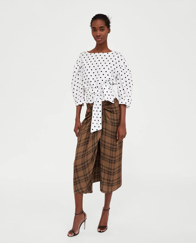"""**Claudia Jukic, Market Editor** <br><br> """"Combine a holiday style sarong shape with business checks and you have the ultimate where-anywhere skirt."""" <br><br> [Skirt]](https://www.zara.com/au/en/check-mini-skirt-p02212676.html?v1=5824048&v2=1010048