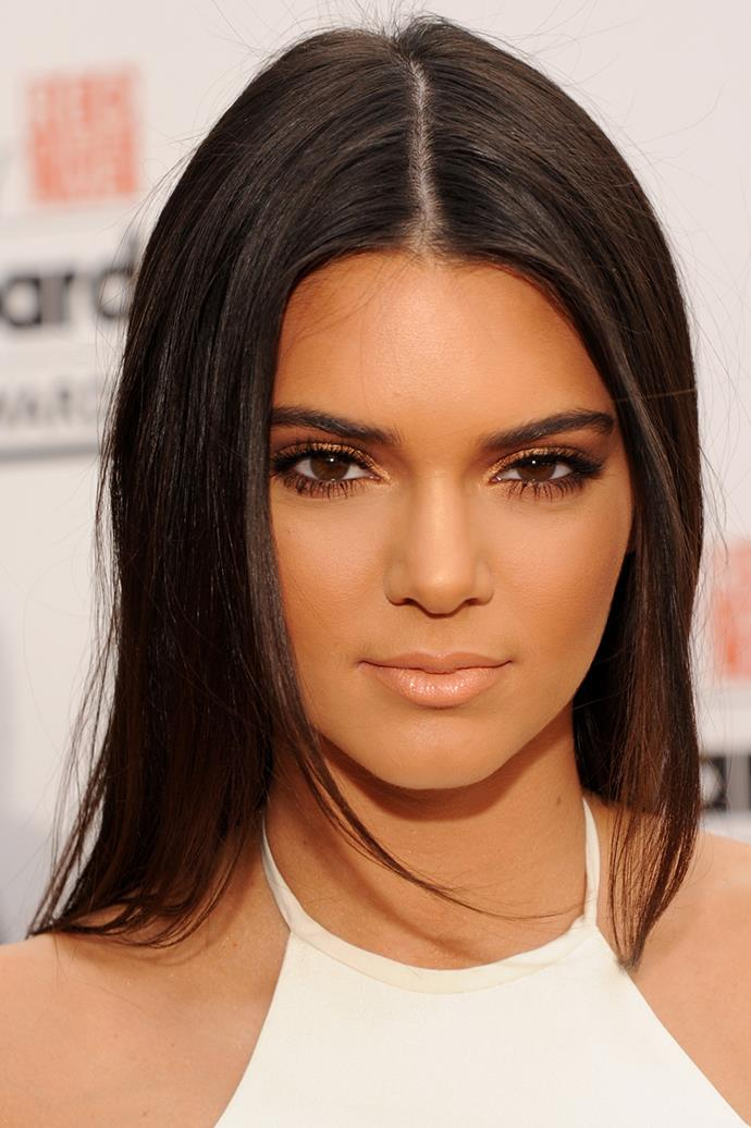 Kendall opted for a bronzed, monochromatic look with nude lips and gold eyeshadow in 2014.