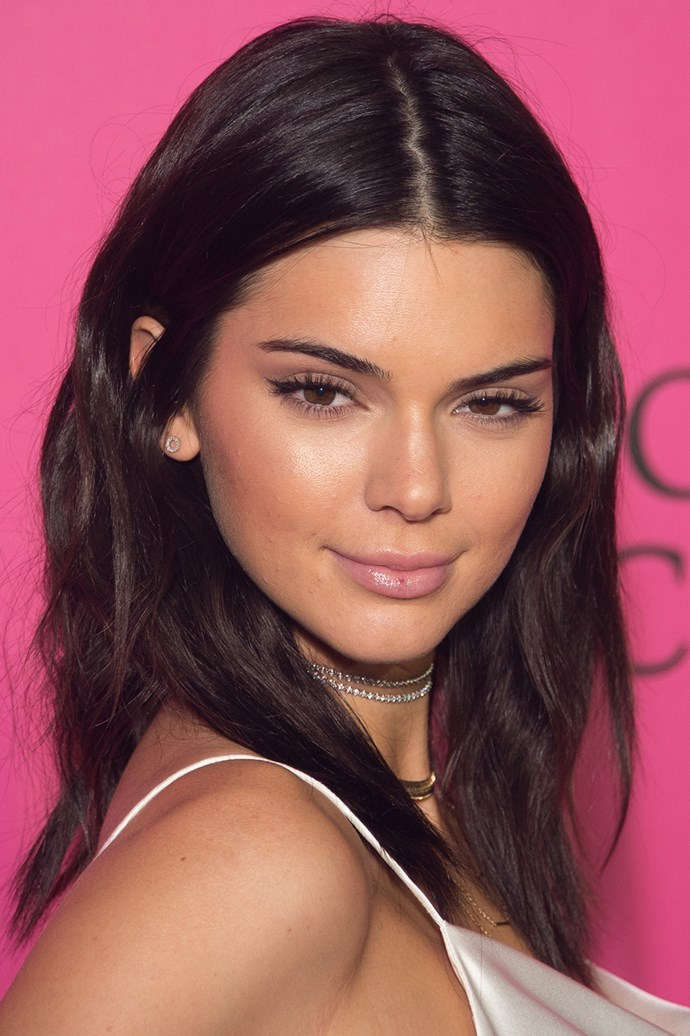 Kendall Jenner's look at the 2016 Victoria's Secret Fashion Show after party consisted of lightly contoured cheeks, a winged eye and pale pink lips with a satin finish.