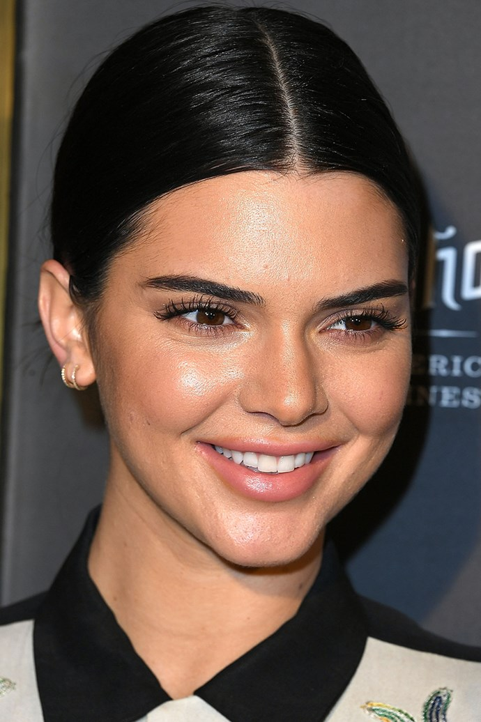 Still sporting that minimalist makeup look, Kendall arrives at a party in Beverly Hills with glowing skin and simple hair in October 11, 2017