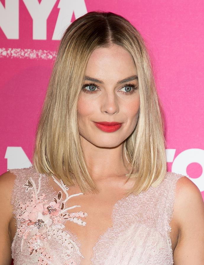 Sleek and straight with a centre part. <br><br> Margot pictured at the Paris premiere of *I, Tonya* in January 2018.