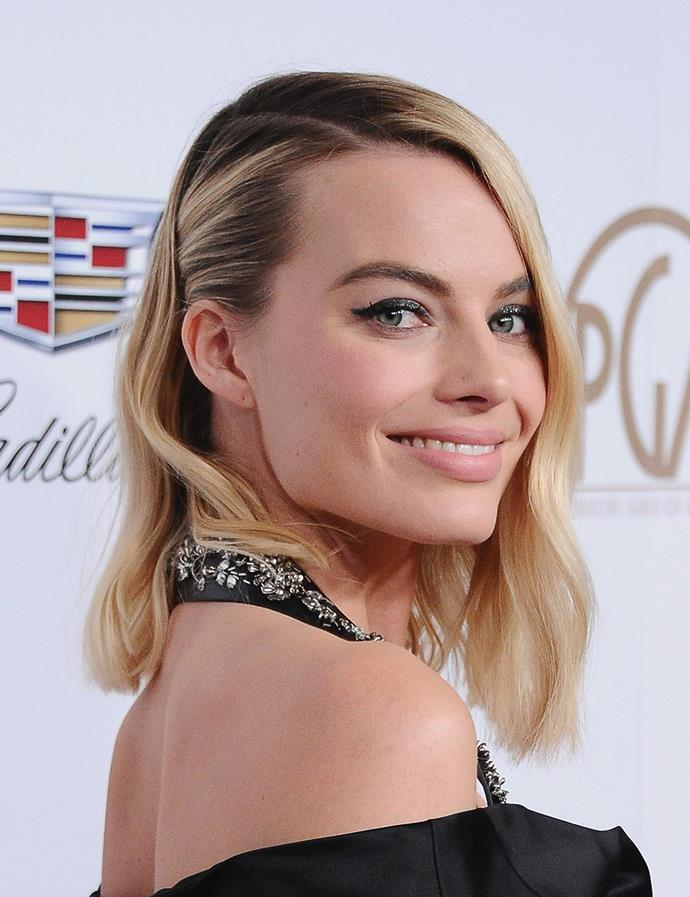 A deep side part with hair slicked back. <br><br> Margot pictured at the Producers Guild Awards in January 2018.