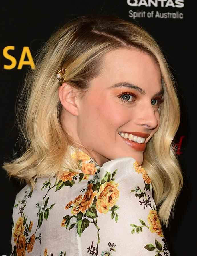 With loose waves and a jewelled hair accessory. <br><br> Margot pictured at the G'Day USA Los Angeles Black Tie Gala in January 2018.