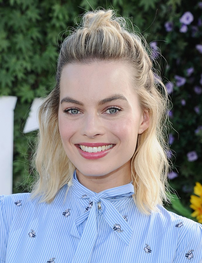 In a messy half-up half-down top knot. <br><br> Margot pictured at a photo call for *Peter Rabbit* in Feb. 2018.