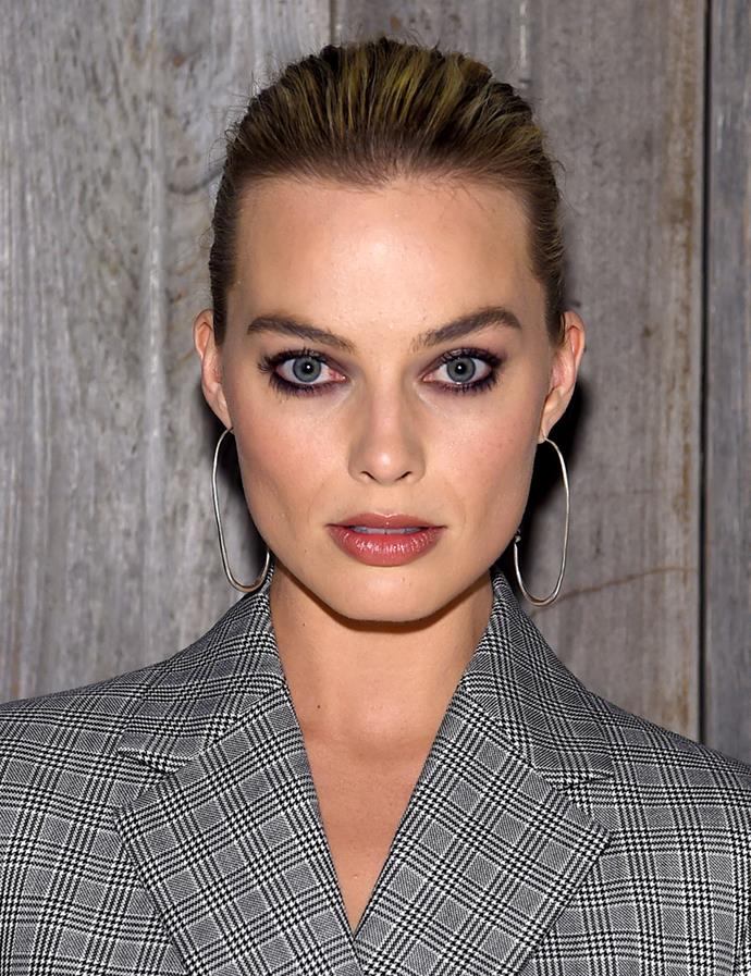 All pulled back. <br><br> Margot pictured at Calvin Klein Collection in February 2018.