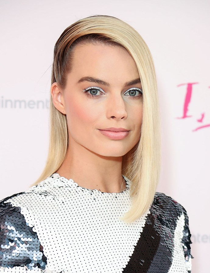Slicked all the way over from one side. <br><br> Margot pictured at the London premiere of *I, Tonya* in February 2018.